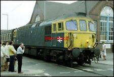 PHOTO  CLASS 33 LOCO THREADS ITS WAY THROUGH THE STREETS OF WEYMOUTH FROM THE DO