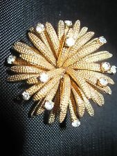 TEXTURED GOLD TONE STARBURSTS SOME ENDING IN ICE RHINESTONES BROOCH