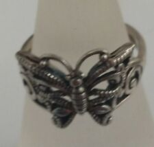 sterling silver ring with  a filigree butterfly finger size q