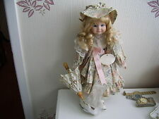 PRETTY PORCELAIN DOLL WITH SOFT BODY WITH WORKING LACE PARASOL AND STAND