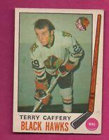 1969-70 OPC # 135 HAWKS TERRY CAFFERY ROOKIE EX-MT CARD (INV#2474)