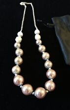 Avon large cream/ taupe/ bronze simulated pearls on a silver coloured chain.