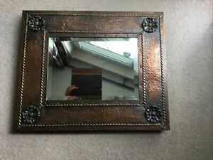 A Superb Arts and Crafts Copper Bevelled Mirror with Repousse Roses.