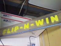 Flip n Win arcade marquee with neon light