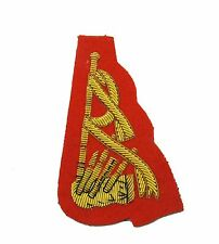 Badge Gold Piper's Sleeve Badge on Red R1678