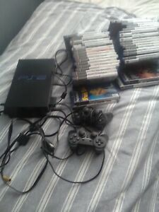 ps2 with controllers and 40 games
