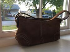 Coach handbag brown leather small and trendy with inside pocket. Excellent shape