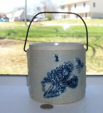 BLUE STENCAL POTTERY BOTTLE WITH WORKING HANDLE. BLUE FLOWERS