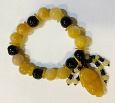 Stretchy Pi Xiu Bracelet Crafted with Black Agate and Yellow Jade Round Beads