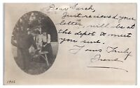 1906 RPPC Sharpening a Hatchet, Meet you at the Depot, Humor Real Photo Postcard