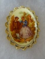Vintage Brooch by Gerry's Gold Tone Painted Porcelain Scene with Man and Woman