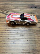 VINTAGE, TYCO SILVER CHROME PINK/ORG CORVETTE,  CURVEHUGGER HP-2 CHASSIS.