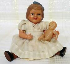 CUTE PAIR ANTIQUE CELLULOID GIRL DOLL WITH BLUE BOW AND CELLULOID BABY DOLL