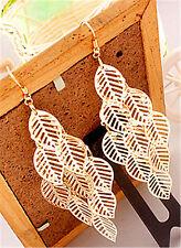 Boho gold tone cut out leaf chandelier dangle earrings