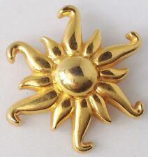 broche vintage motif soleil couleur or en relief 399