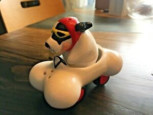 Ceramic Dog In Bone Race Car Salt & Pepper Shaker in Box. Used for Display Only
