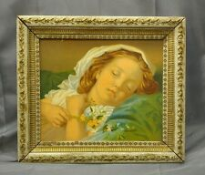 Antique old vintage picture frame with lithograph print of sleeping girl