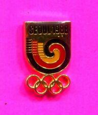 1988 SEOUL OLYMPIC PIN SEOUL LOGO OVER GOLD OLYMPIC RINGS PIN