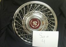 "SET OF 4 - NEW!!!! NOS GM CADILLAC 14"" WIRE WHEEL HUBCAPS WITH CENTER CAPS FWD"