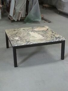 Verde Versilia marble topped coffee table 100x100cm  on black steel frame.