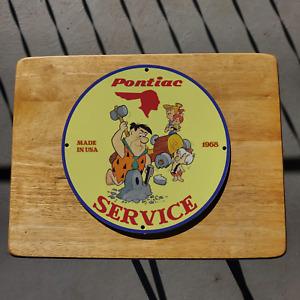 Vintage 1968 Pontiac Repair Service 'The Flintstones' Porcelain Gas & Oil Sign