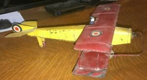 Kingsbury windup pressed steel Airplane with cast iron pilot