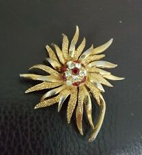 pretty gold tone brooch with faceted faux stones
