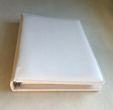 white 3-ring binder plannerwith tabs and grid paper