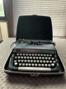 Portable Smith Corona Super Sterling Typewriter with Case