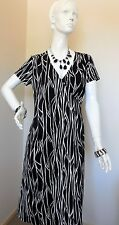 FACTORY OUTLET BLACK AND WHITE STRETCHY DRESS SIZE 12to14  END ON 28th