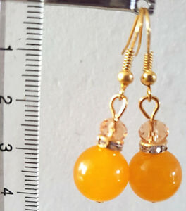 Gold tone earrings with natural orange agate and glass crystal beads