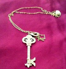 KENNETH JAY LANE KEY NECKLACE WITH A PINK RIBBON ACCENT  COMMEMORATING CANCER