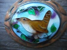 VINTAGE ENAMEL PIN DEPICTING A WREN IN SILVER SETTING ON COPPER BACKGROUND