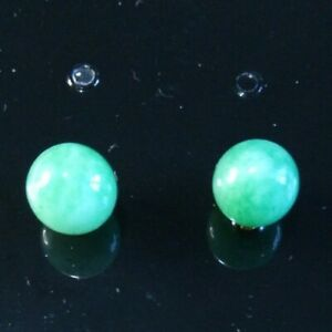 Green jade stone studs.