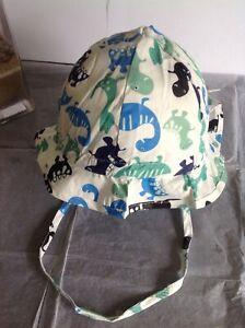 BN Licus Meek Era Baby White/Dinosaur Print Sun Hat Flap/Chin Strap 6-12mths.