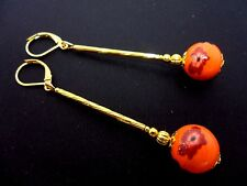 A PAIR OF LONG ORANGE PORCELAIN BEAD  GOLD PLATED LEVERBACK HOOK EARRINGS. NEW.