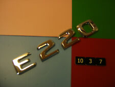 GENUINE MERCEDES BENZ E220 CHROME PLASTIC REAR BADGE EMBLEM. A 124 817 55 15