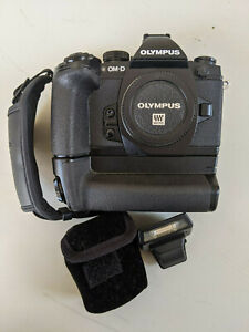 Olympus OM-D E-M1 16 MP Digital SLR Camera Bundle with HLD-7 Grip and GS-5 Strap