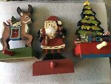 Set Of Three Weighted Wooden Christmas Stocking Hangers