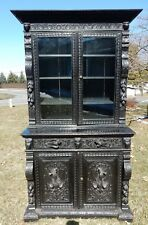 A Continental Ebonized Intricately Carved Oak Cabinet, 19th Century 88.5""