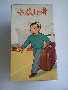 vintage tin toy wind up Young traveller with suitcase China MIB MS 823 ME MF