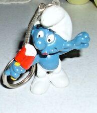 1979 dated Peyo Smurf eating Popsicle Key Chain Brainy Smurf