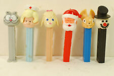 6 Pez containers, 50's