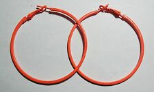 Bijou fantaisie : boucles d'oreille créoles orange fluo - diamètre 5,5 cm