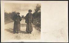 RPPC Real Photo Postcard ~ Man & Woman Wearing Full Length Fur Coats & Old Auto