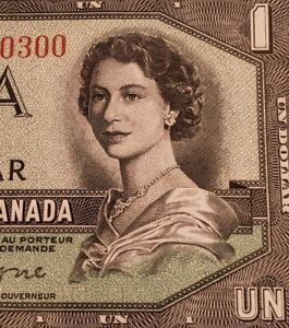1954 Canada $1 Banknote. RARE DEVIL FACE & LOW SERIAL NUMBER.