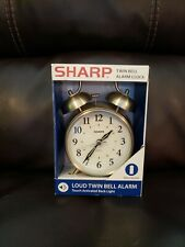 Sharp Analog Twin Bell Quartz Alarm Clock w/Touch Activated Back Light. Preown