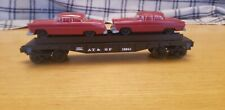 18/181 LIONEL MODERN ERA MPC O GAUGE  AUTO FLAT CAR 16941 WITH 2 RED AUTOMOBILES