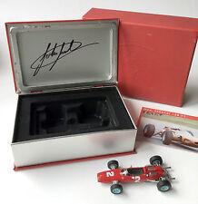 John Surtees SIGNED Ferrari 158 winner Monza 1964, La Storia 1:43 book tin, COA