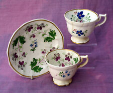 Late 18thC cup and saucer with flower painting and one other cup. c1790